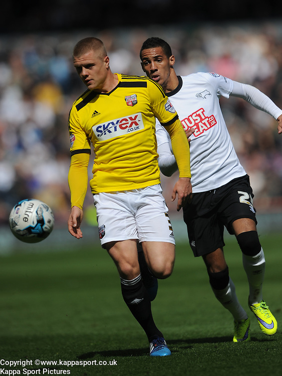 Derby Tom Ince, holds of battles with Brentford Jake Bidwell, Derby County v Brentford, Sy Bet Championship, IPro Stadium, Saturday 11th April 2015. Score 1-1,  (Bent 92) (Pritchard 28)<br /> Att 30,050