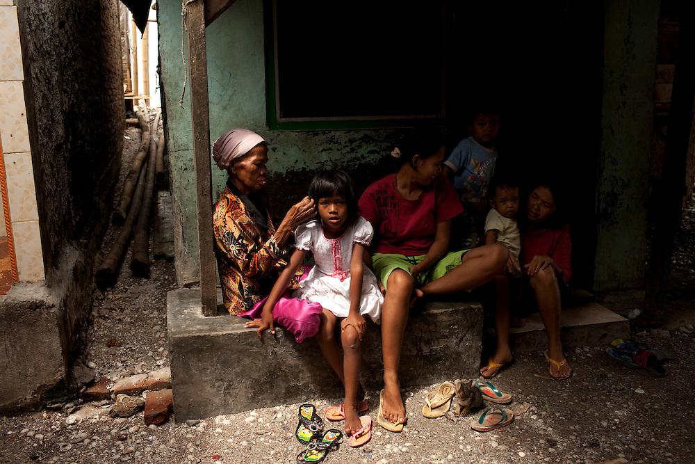 Family in slum area in North Jakarta, Jakarta, Indonesia.