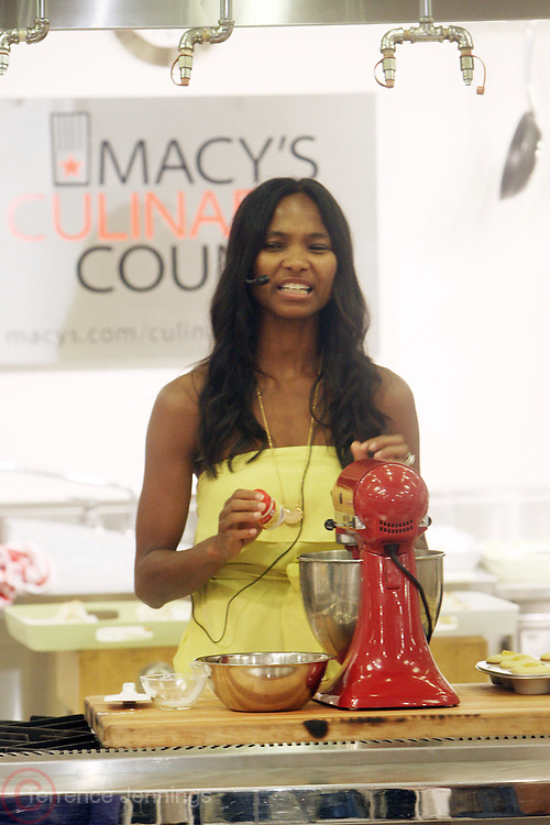 15 July 2010- New York, NY- Nicole Friday of CupCake Craze demonstrates her baking techniques at Macy's Cellar Kitchen Battle of the Summer Favorites held at Macy's Herald Square on July 15, 2010 in New York City.