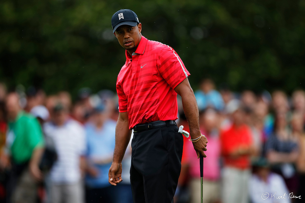 TIGER WOODS after his putt on the first hole during the final round of the Arnold Palmer Invitational at the Bay Hill Club and Lodge.
