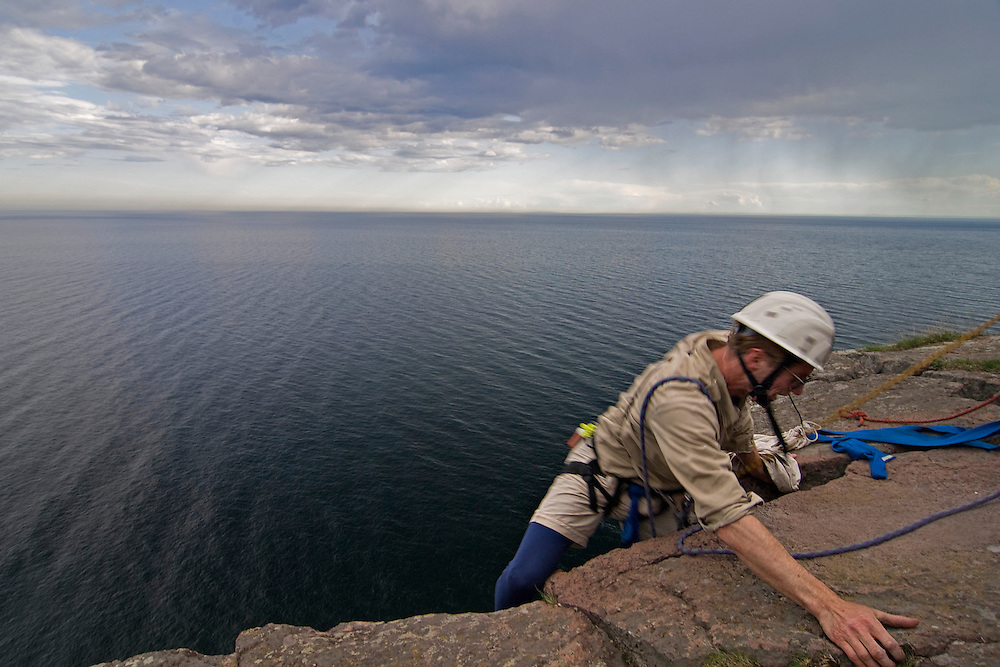 Rock climbing at Palisade Head on Lake Superior at Minnesota North Shore near Duluth.