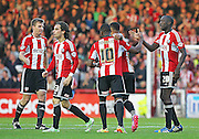 Brentford's Andre Gray celebrates his equaliser 1-1 during the Sky Bet Championship match between Brentford and Derby County at Griffin Park, London, England on 1 November 2014.