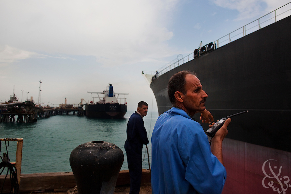 Iraq Southern Oil Company workers direct a tanker ship to port at the Al Basrah oil terminal (ABOT) 50 kilometers off the coast of Iraq in the Northern Arabian Gulf February 2, 2010. Iraqi oil exports account for an estimated 75 percent of the country's GDP, and an estimated 85-90 percent of Iraqi oil exports in total come out through this vital terminal originally constructed in the 1970's. (Photo by Scott Nelson/Agentur FOCUS)