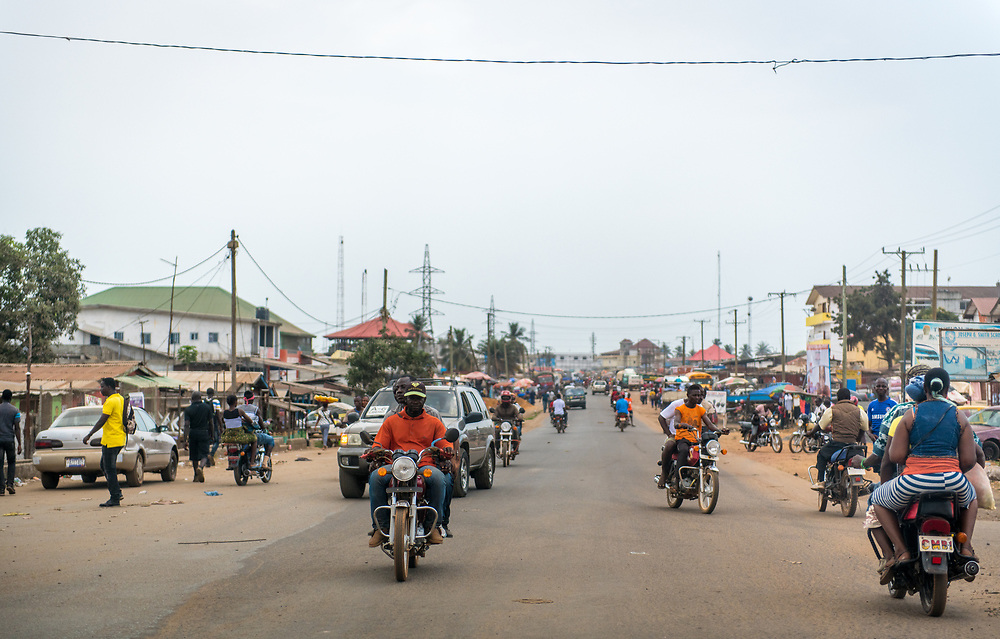 Motorists travel down a bustling street in the city of Monrovia, Liberia
