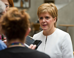Pictured: <br /> No time to relax for Nicol;a Sturgeon after First Minister's questions at the Scottish Parliament with so many pressure groups seeking a moment of her time to press their case and grab the all important selfie.<br /> <br /> <br /> Ger Harley | EEm 23 May 2019