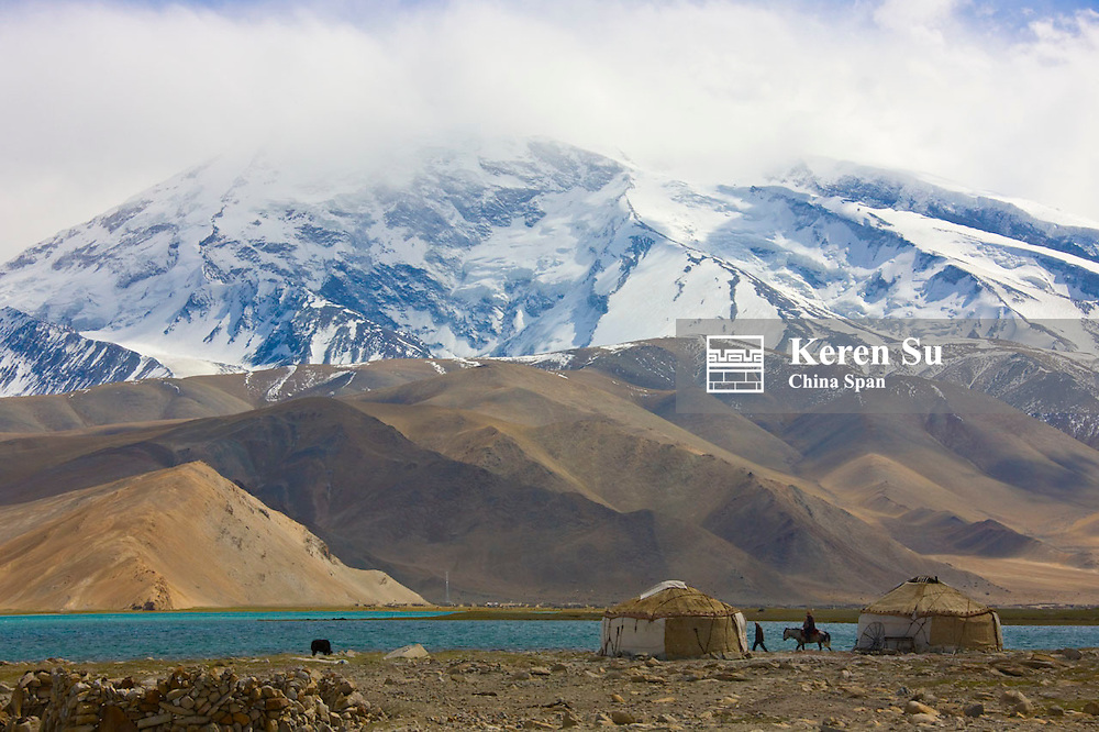 Kirghiz people's yurts by Karakuli Lake, Mt. Kunlun in the distance, Pamir Plateau, Xinjiang, China