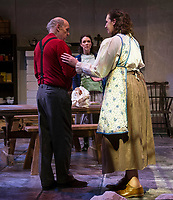 A confused Ken Chapman (Father Jack) is comforted by his sister Margaret Lundberg (Agnes Mundy) during dress rehearsal for Dancing at Lughnasa with the Winnipesaukee Playhouse on Tuesday evening.  (Karen Bobotas/for the Laconia Daily Sun)