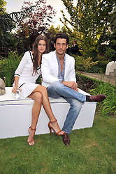 DAVID GANDY and CHLOE PRIDHAM at The Ralph Lauren Sony Ericsson WTA Tour Pre-Wimbledon Party hosted by Richard Branson at The Roof Gardens on June 18, 2009