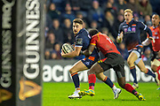 Charlie Shiel (#21) of Edinburgh Rugby looks to offload as he is tackled during the Guinness Pro 14 2018_19 rugby match between Edinburgh Rugby and Isuzu Southern Kings at the BT Murrayfield Stadium, Edinburgh, Scotland on 5 January 2019.