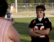 Pame Fruhwirth (left) takes a picture of Lauren Fruhwirth after the 3rd Annual Powderpuff Challenge, the junior girls (class of 2008) against the senior girls (class of 2007.)  The seniors won, 14-0.