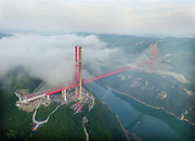 GUIYANG, CHINA - JULY 16: <br /> <br /> Aerial view of a bridge connecting express highway between Guiyang City and Qianxi County on July 16, 2016 in Guiyang, Guizhou Province of China. Guiyang-Qianxi express highway is an important part in Guizhou\'s high-speed structures, with a length of 78.436 kilometers and a total investment of about 9.012 billion. It\'s said that there will be reduce to only fifty minutes drive from former two hours from Guiyang City to Qianxi County after the high-speed opens.<br /> ©Exclusivepix Media