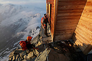 """Alpinists at Solvay hut.<br /> <br /> """"Matterhorn 150 years Cervino"""" - The year 2015 is the 150th Anniversary of the first ascent by Edward Whymper from the Swiss side (14th July) and by Jean Antoine Carrel from the Italian side on the 17th July 1865.<br /> <br /> On 17th July 2015 a friendship convention was signed by the members of Swiss, French, British and Italian climbing teams. A ceremony was held at the summit in honour of the mountain."""