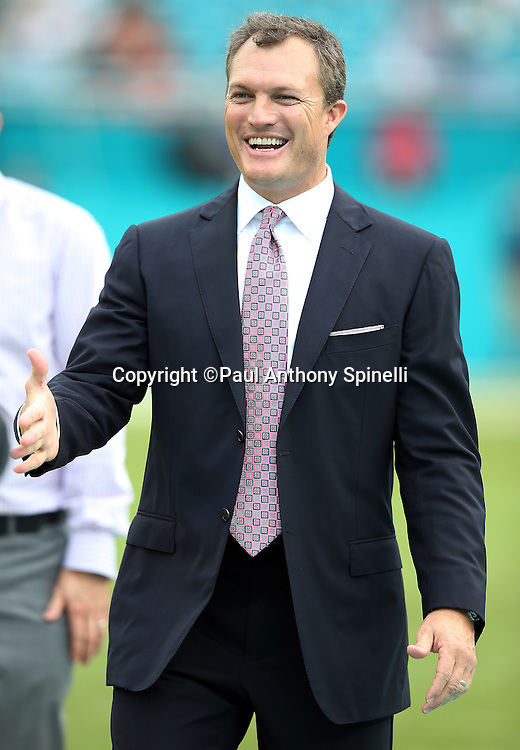 Former Tampa Bay Buccaneers defensive back John Lynch smiles as he greets another former player during a sideline visit before the Miami Dolphins 2015 week 11 regular season NFL football game against the Dallas Cowboys on Sunday, Nov. 22, 2015 in Miami Gardens, Fla. The Cowboys won the game 24-14. (©Paul Anthony Spinelli)