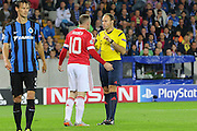 Wayne Rooney of Manchester United argues with Referee from Spain Antonio Mateu Lahoz during the Champions League Qualifying Play-Off Round match between Club Brugge and Manchester United at the Jan Breydel Stadion, Brugge, Belguim on 26 August 2015. Photo by Phil Duncan.