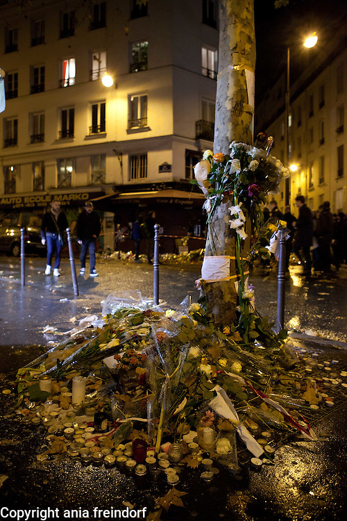 Paris Attacks Cafe La Bonne Biere, people mourning place where 5 victims died from Kalashnikov, terrorist attack on 13/11/15.