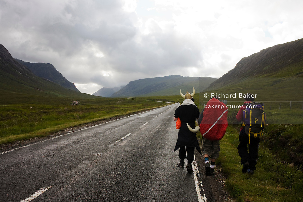 Viking horn helmet friends on pagan fertility Wassail walk rite, from Glasgow through Glencoe.