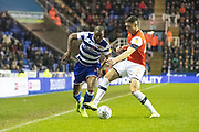 Yakou Meite (19) of Reading and Lloyd Jones of Luton Town during the EFL Sky Bet Championship match between Reading and Luton Town at the Madejski Stadium, Reading, England on 9 November 2019.