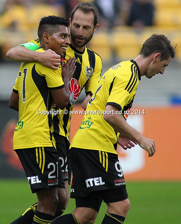 Phoenix Andrew Durante hugs Roy Krishna after he scores a penalty during the A-League football match between the Wellington Phoenix & Western Sydney Wanderers at Westpac Stadium, Wellington, 28 December 2014. Photo.: Grant Down / www.photosport.co.nz