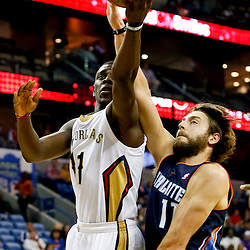 Nov 2, 2013; New Orleans, LA, USA; New Orleans Pelicans point guard Jrue Holiday (11) shots over Charlotte Bobcats power forward Josh McRoberts (11) during the first quarter of a game at New Orleans Arena. Mandatory Credit: Derick E. Hingle-USA TODAY Sports