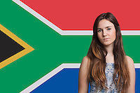 Portrait of young woman against South African flag