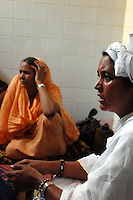 Niger,Niamey,2007. Fatima Ixa, right, and Mohammad Ixa's first wife Aissa Hamini confront the medical emergency that has stricken Rissa Ixa's friend.