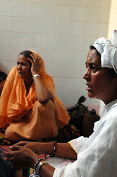 Niger,Niamey,2007. Fatima Ixa, right, and Mohammad Ixa's first wife Aissa Hamini confront the medical emergency that has stricken Rissa Ixa's friend.