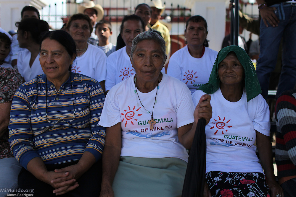 "Women sit at a protest with shirts that read: ""Guatemala, Free of Mining."" Hundreds gathered in the main square of San Rafael Las Flores, Guatemala, to demand that a community plebiscite on industrial mining be carried out in the municipality. The San Rafael Mine, 60% owned by US-based Tahoe Resources and 40% by Canadian mining giant Goldcorp, has been operating since 2011 without having previously consulted the local residents - a violation to numerous international conventions. San Rafael Las Flores, Santa Rosa, Guatemala. July 20, 2012."