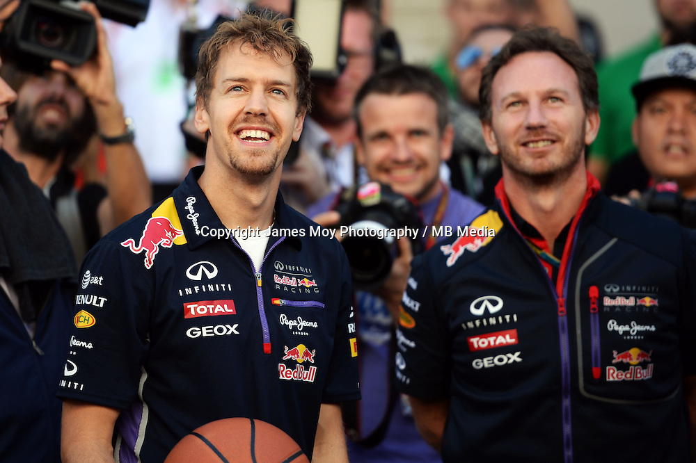 (L to R): Sebastian Vettel (GER) Red Bull Racing practices his basketball skills with Christian Horner (GBR) Red Bull Racing Team Principal.<br /> United States Grand Prix, Saturday 1st November 2014. Circuit of the Americas, Austin, Texas, USA.