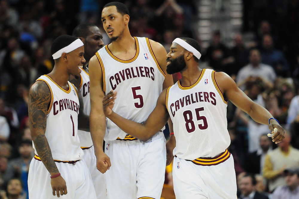 March 29, 2010; Cleveland, OH, USA; Cleveland Cavaliers point guard Daniel Gibson (1) center Ryan Hollins (5) and Clevelad point guard Baron Davis (85) celebrate during the final minute of the fourth quarter against the Miami Heat at Quicken Loans Arena. The Cavaliers beat the Heat 102-90. Mandatory Credit: Jason Miller-US PRESSWIRE