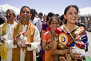 18 MAY 2008 -- MARICOPA, AZ: People process around the temple during the dedication of a new Hindu temple in Maricopa, AZ, Sunday. More than 3,000 Hindus from Arizona, southern California and New Mexico came to Maricopa, a small town in the desert about 50 miles south of Phoenix, for the dedication of the Maha Ganapati Temple of Arizona. It is the first Hindu temple in Arizona designed according to ancient South Indian Hindu architectural guides. Craftsmen from India came to Maricopa to complete the interior details of the temple. The dedication ceremonies lasted three days.   Photo by Jack Kurtz / ZUMA Press