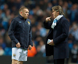 WIGAN, ENGLAND - Monday, March 29, 2010: Manchester City's manager Roberto Mancini prepares to bring on substitute Craig Bellamy at half-time during the Premiership match against Wigan Athletic at the City of Manchester Stadium. (Photo by David Rawcliffe/Propaganda)