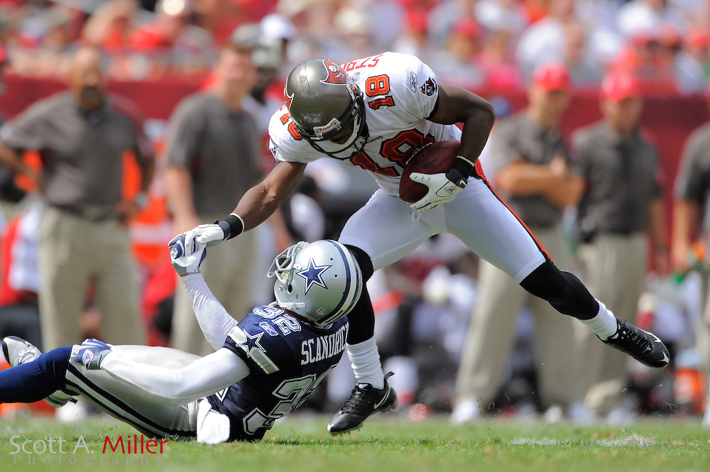 Sept 13, 2009; Tampa, FL, USA; Tampa Bay Buccaneers wide receiver Sammie Stroughter (18) avoids Dallas Cowboys cornerback Orlando Scandrick (32) during their game at Raymond James Stadium. ©2009 Scott A. Miller
