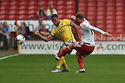 Jordan Clarke of Scunthorpe United and Sheffield United midfielder Matt Done (14) during the Sky Bet League 1 match between Sheffield Utd and Scunthorpe United at Bramall Lane, Sheffield, England on 8 May 2016. Photo by Ian Lyall.