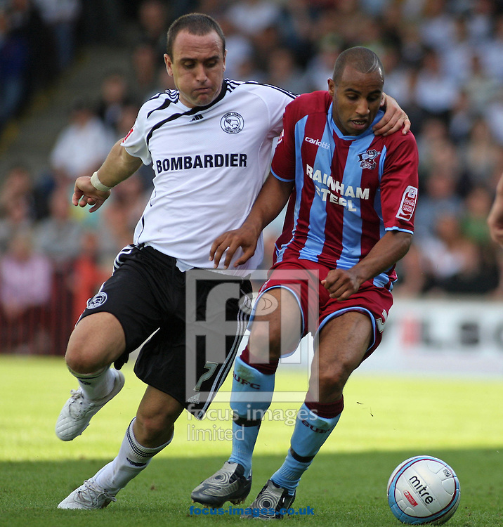 Scunthorpe - Saturday August 15th, 2009: Marcus Williams of Scunthorpe United and Lee Croft of Derby County battle for the ball during the Coca Cola Championship match at Glanford Park Scunthorpe. (Pic by Steven Price/Focus Images)..