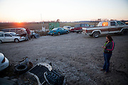 Lauren Burnett stands in front of the family business, the junkyard at Boggs Auto Salvage and Sales.