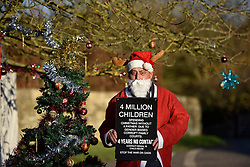 © Licensed to London News Pictures. 24/12/2014. Dean, Oxfordshire UK. James Dennis. Fathers for Justice protestors plan to spend Christmas protesting in the village of Dean where the Prime Minister David Cameron lives. The protestors are led by Bobby Smith, long time protestor who protested to David Cameron during his surf holiday at Polzeath in August 2014. Photo credit : MARK HEMSWORTH/LNP