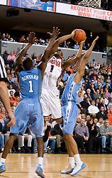 Virginia guard Jeff Jones (1) shoots over North Carolina guard/forward Marcus Ginyard (1).  The Virginia Cavaliers men's basketball team fell to the #3 ranked North Carolina Tar Heels 75-74 at the John Paul Jones Arena in Charlottesville, VA on February 12, 2008.
