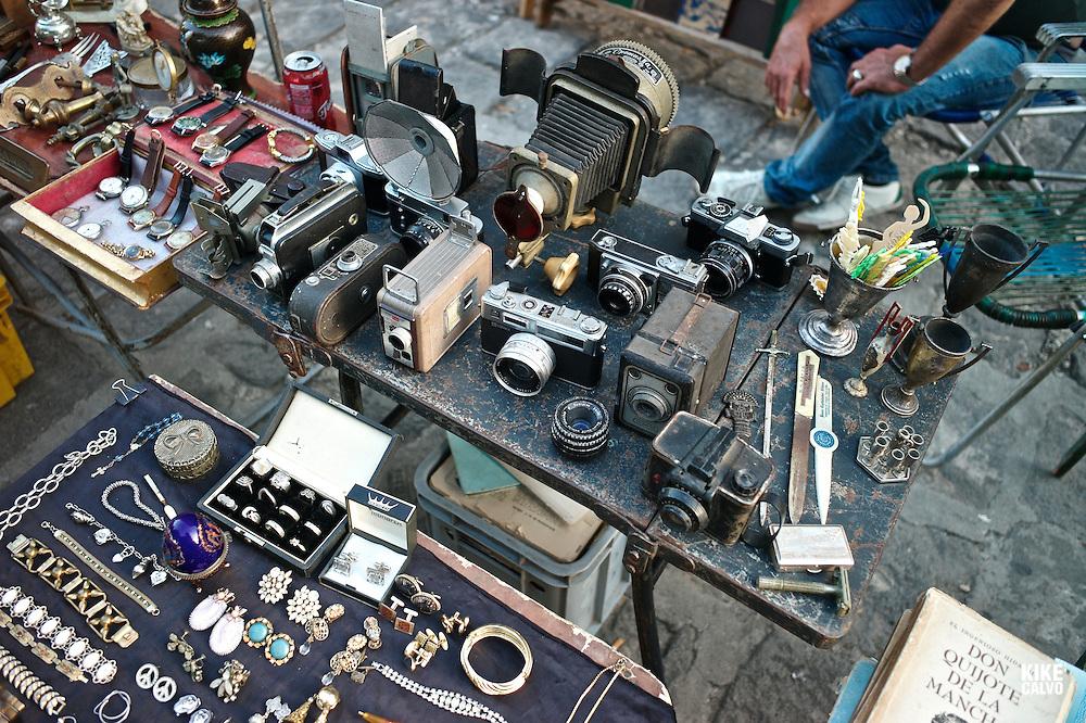 Colorful stands around Plaza de Armas sell memorabilia, including vintage cameras, jewlery,