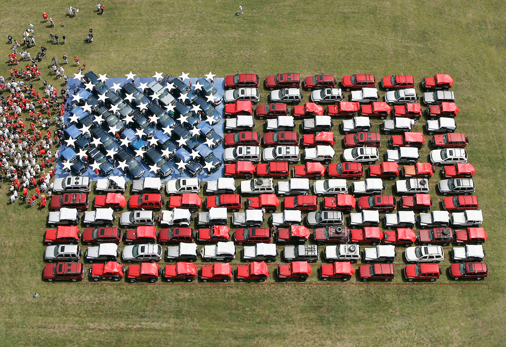 Jeep owners position 140 vehicles in the form of an American flag, Thursday, Aug. 11, 2005, in Mount Pocono, PA, to promote the National Anthem Project, a national effort to re-teach Americans the words to 'The Star-Spangled Banner.' The flag, measuring 73 feet wide and 191 feet long, was created to celebrate the first year of this multi-year national education initiative of which Jeep is a national sponsor. (Photo/Stuart Ramson, Jeep)