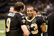 NEW ORLEANS, LA - DECEMBER 26:   Quarterback Drew Brees #9 of the New Orleans Saints is congratulated by Pierre Thomas #23 after Brees throws a nine-yard touchdown pass to running back Darren Sproles #43 and breaks the single-season passing record in the fourth quarter against the Atlanta Falcons at Mercedes-Benz Superdome on December 26, 2011 in New Orleans, Louisiana.  The Saints defeated the Falcons 45-16.  (Photo by Wesley Hitt/Getty Images) *** Local Caption *** Drew Brees; Pierre Thomas
