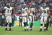 The Big Guys of the Eagles offence , Philadelphia Eagles Jason Peters OT (71) , Philadelphia Eagles Jason Kelce C (62), Philadelphia Eagles Isaac Seumalo G (73) and Philadelphia Eagles Brandon Brooks G (79) during the International Series match between Jacksonville Jaguars and Philadelphia Eagles at Wembley Stadium, London, England on 28 October 2018.