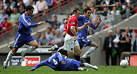Photo: Paul Thomas.<br /> Chelsea v Manchester United. The FA Cup Final. 19/05/2007.<br /> <br /> Wayne Rooney (Red) of Utd leaves Chelsea players in his wake, Wayne Bridge (L), Claude Makelele (Ground) and Paulo Ferreira (R).