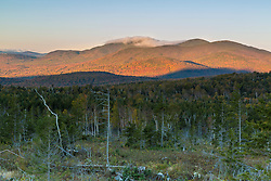 Fog covers the summit of Saddleback Mountain as seen from the western slopes of Mount Abraham in Maine's High Peaks Region.
