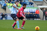 Peterborough United midfielder Erhun Oztumer gets away from Coventry City midfielder Romain Vincelot during the Sky Bet League 1 match between Coventry City and Peterborough United at the Ricoh Arena, Coventry, England on 31 October 2015. Photo by Alan Franklin.