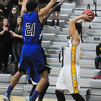 Trask's Kobe Owsley guards Topsail's Blake Nelson Friday December 5, 2014 at Topsail High School in Hampstead, N.C. (Jason A. Frizzelle)