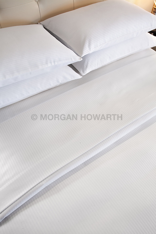 Hotel bed linens with pillows