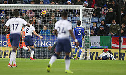 Tottenham Hotspur's Dele Alli (right) scores his side's second goal of the game during the Premier League match at the King Power Stadium, Leicester.