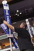 A worker makes last minute preparations for the start of the Democratic National Convention at the Wells Fargo Center July 24, 2016 in Philadelphia, Pennsylvania.