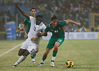 Photo: Steve Bond/Richard Lane Photography.<br /> Ghana v Morocco. Africa Cup of Nations. 28/01/2008. Sulley Muntari (L) tangles with Youssef Hadji (R)