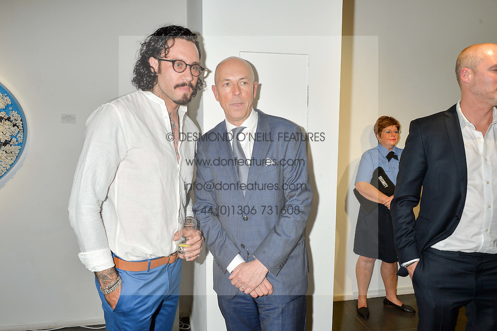 Left to right, artist MIKE DARGAS and DYLAN JONES at a private view of woks by German artist Mike Dargas held at the Opera Gallery, 134 New Bond Street, London on 5th July 2016.